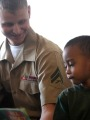 Service Member Helping a Child