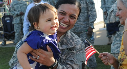 Service member with her daughter
